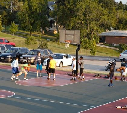 Men playing basketball at Schroeder Park